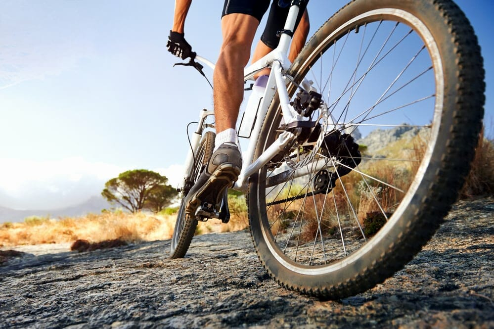 A picture showing a mountain biker riding an MTB
