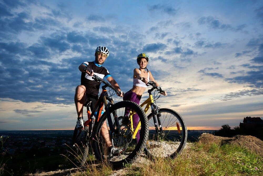 A photo showing young people riding mountain bikes